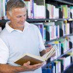 senior-man-reading-in-a-library_bthygcbo